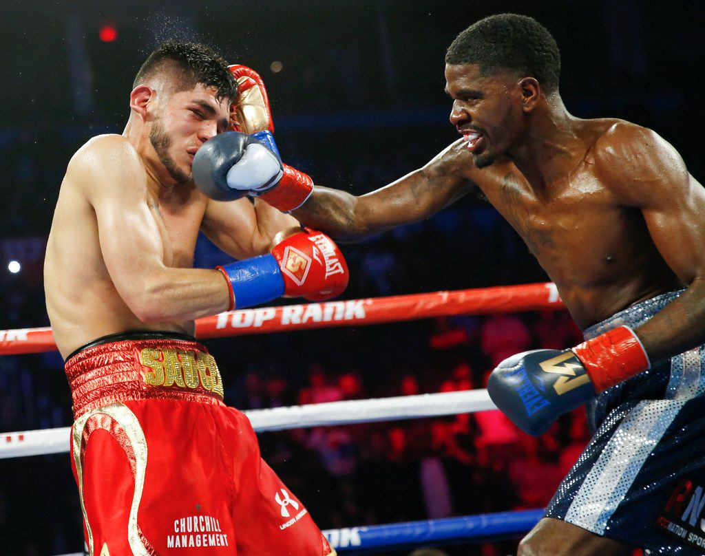 Maurice Hooker, right, punches Alex Saucedo during their WBO junior welterweight world title bout at Chesapeake Energy Arena in Oklahoma City, Friday, Nov. 16, 2018. Maurice Hooker, right, punches Alex Saucedo during their WBO junior welterweight world title bout at Chesapeake Energy Arena in Oklahoma City, Friday, Nov. 16, 2018. Photo by Nate Billings, The Oklahoman