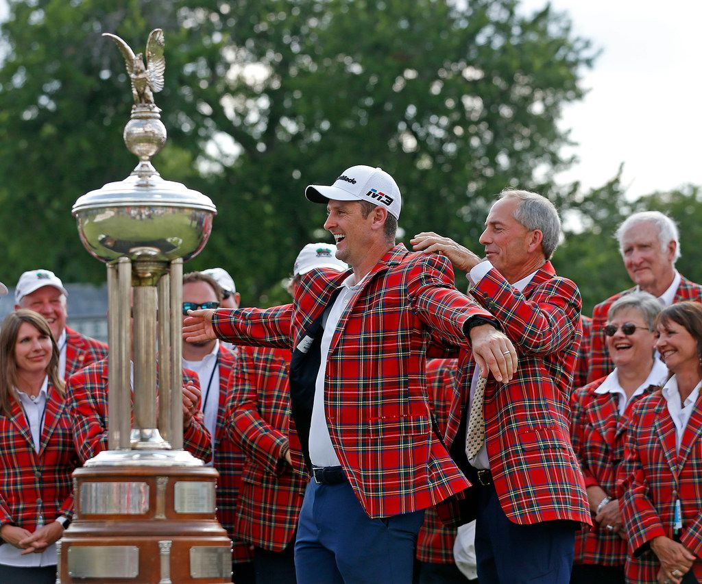 Winner Justin Rose, left, accepts the winners plaid jacket from Colonial golf pro Dow Finsterwald after the final round of Fort Worth Invitational at Colonial Country Club in Fort Worth, Texas, Sunday, May 27, 2018. (Jae S. Lee/The Dallas Morning News)