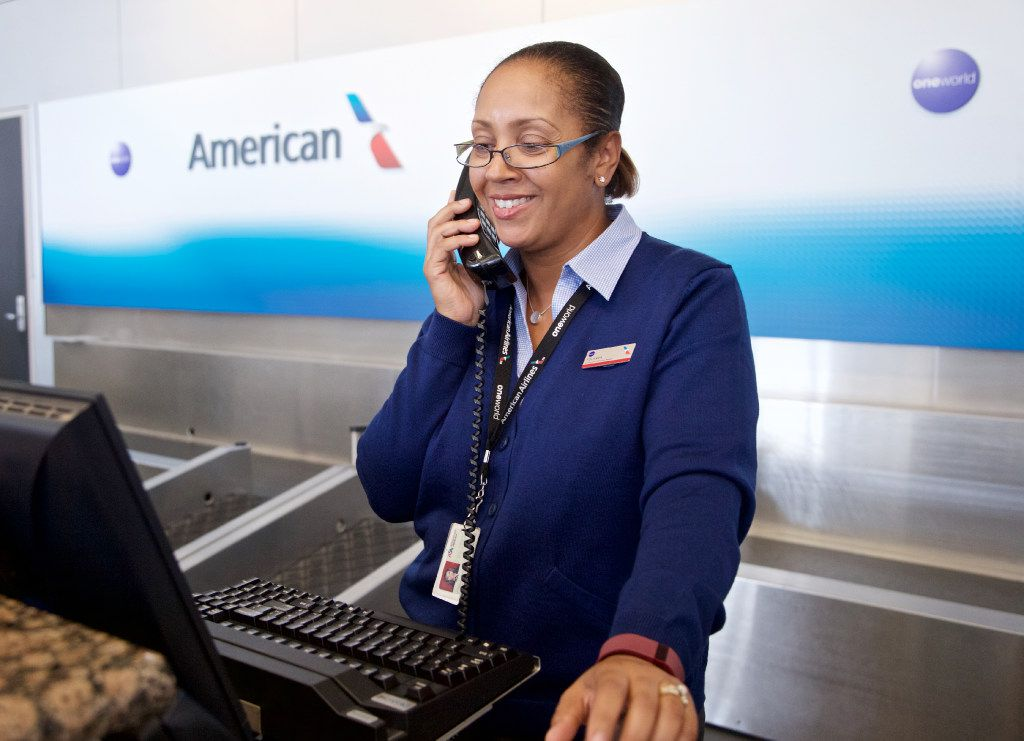 American Airlines workers have received high double-digit pay increases in the past six years. In this 2016 photo, customer service agent Yolanda Walter helps a caller at DFW International Airport.