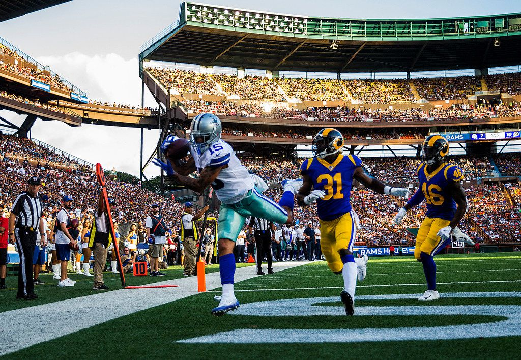 Dallas Cowboys wide receiver Devin Smith (15) catches a pass in the end zone for a touchdown ahead of Los Angeles Rams defensive back Darious Williams (31) during the third quarter of an NFL preseason game between the Dallas Cowboys and the Los Angeles Rams on Friday, August 17, 2019 at Aloha Stadium in Honolulu, Hawaii. (Ashley Landis/The Dallas Morning News)