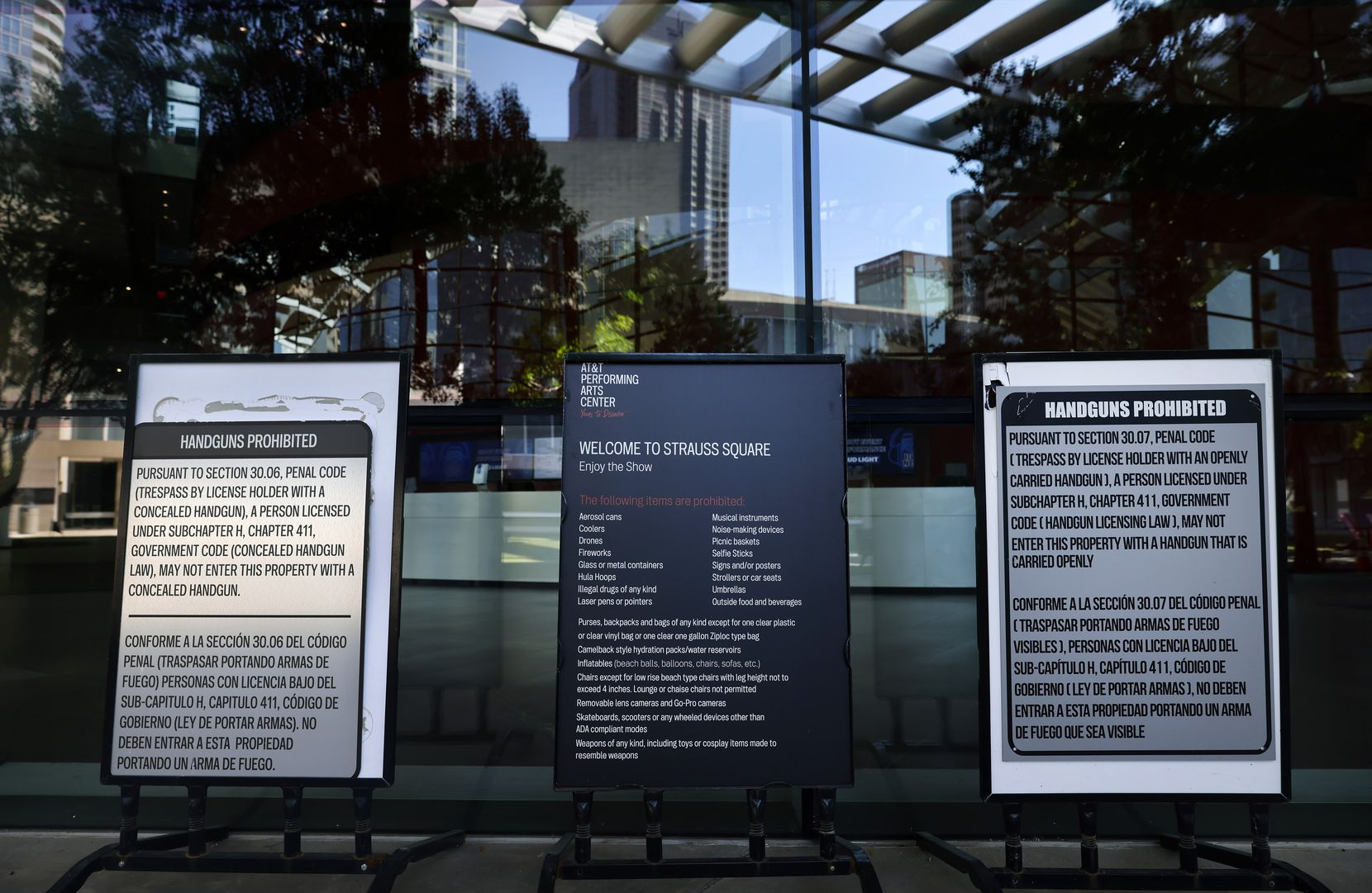 Signs banning patrons at the AT&T Performing Arts Center from carrying weapons on premises are shown on Aug. 31.