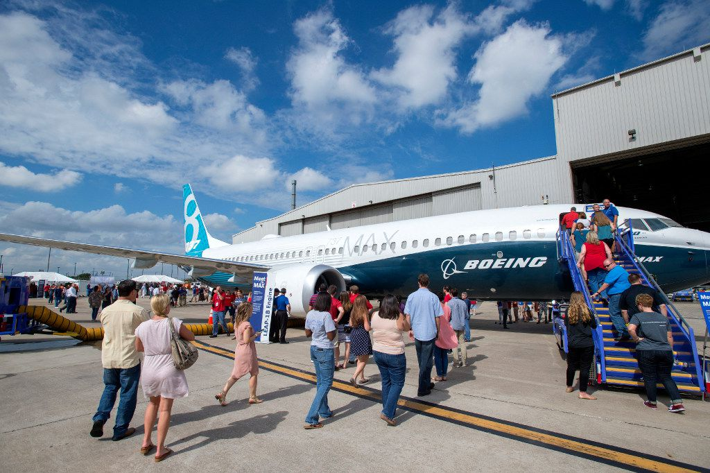 Southwest Airlines employees line up to have a first look at the new Boeing 737 MAX jetliner at Love Field in Dallas on Friday, September 23, 2016.  Southwest will be the first customer to fly the new airplanes. (Jeffrey McWhorter/Special Contributor)