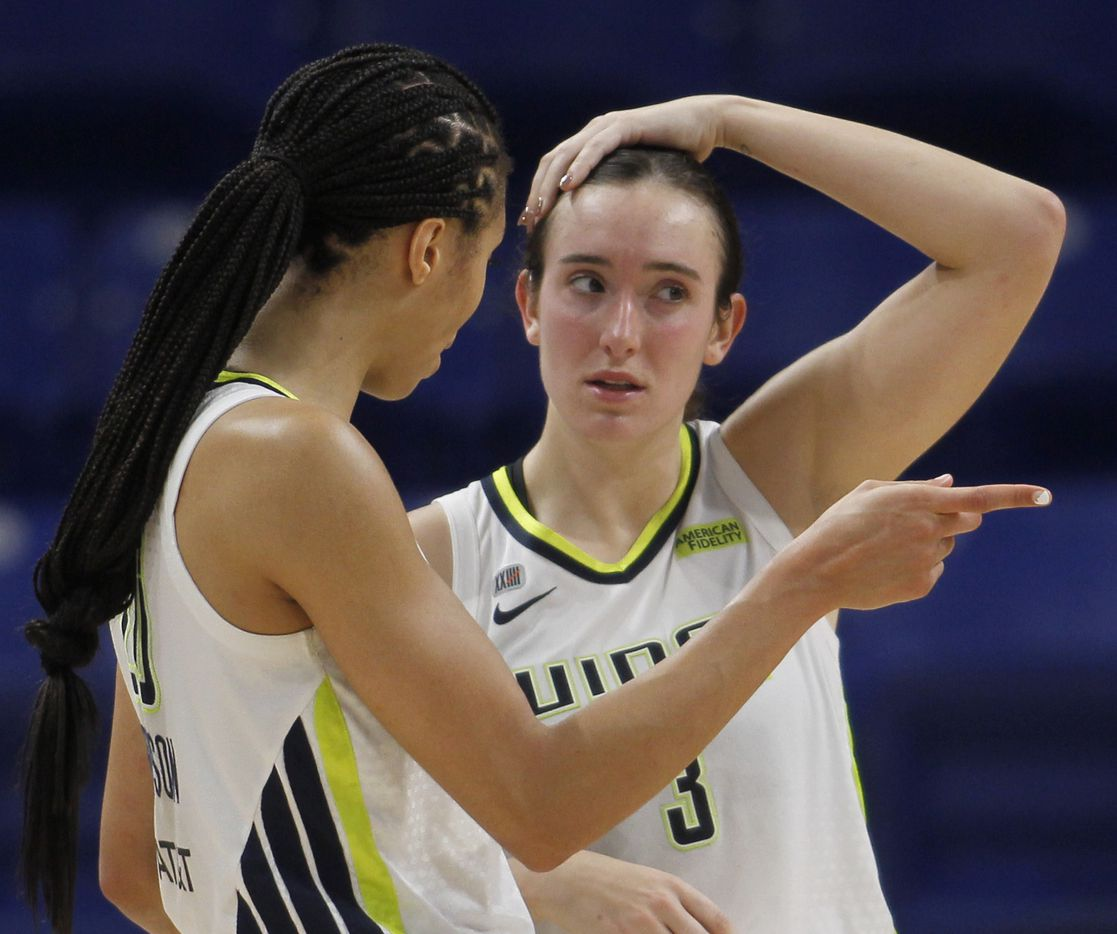 Dallas Wings guard Marina Mabrey (3), right, converses Wings forward Isabelle Harrison (20) during a timeout during second half action against the Chicago Sky. Dallas defeated Chicago 100-91. The two WNBA teams played their game at College Park Center in Arlington on July 2, 2021. (Steve Hamm/ Special Contributor)