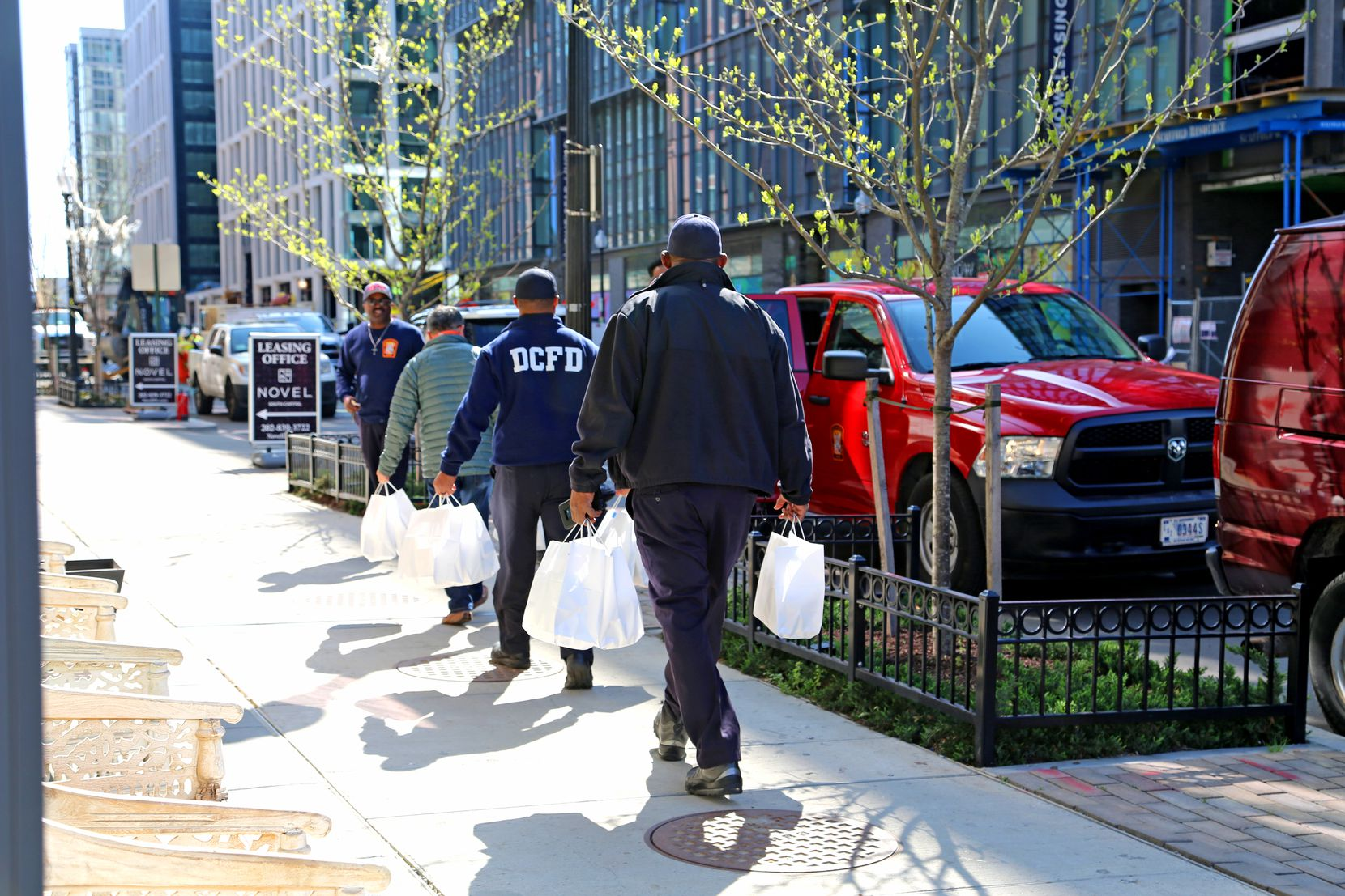D.C. firefighters deliver meals as part of the Power of 10 Initiative.