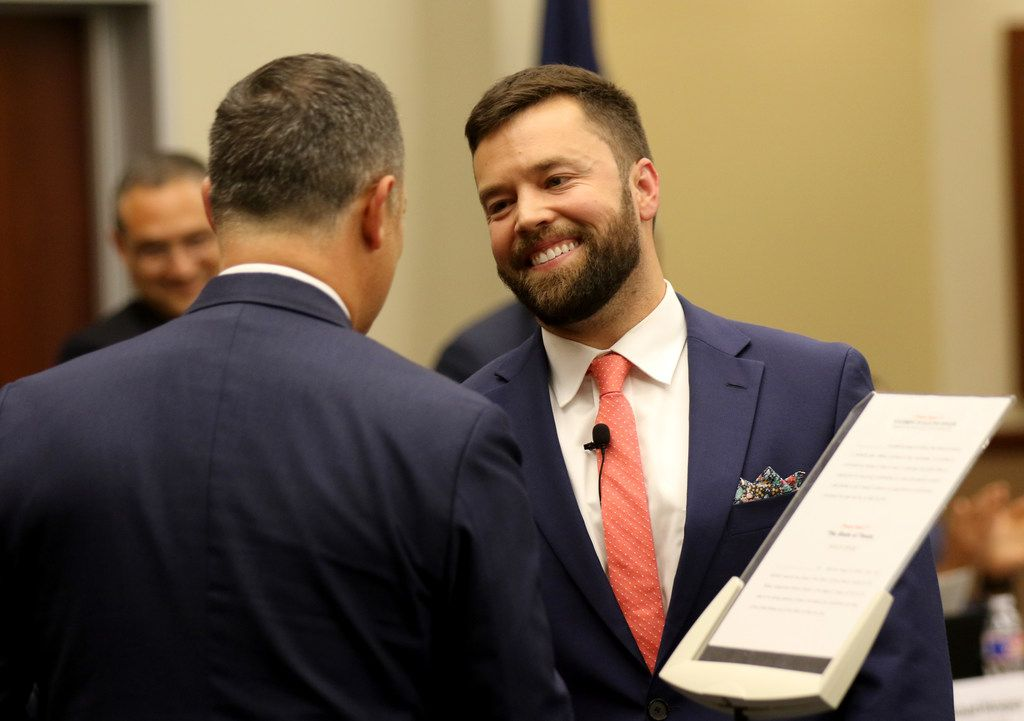 New trustee Ben Mackey smiles after being sworn into the Dallas ISD board by state Rep.Rafael Anchia, D-Dallas.  Ben Mackey, former principal of School for the Talented and Gifted and now an administrator with DeSoto, takes the District 7 seat.