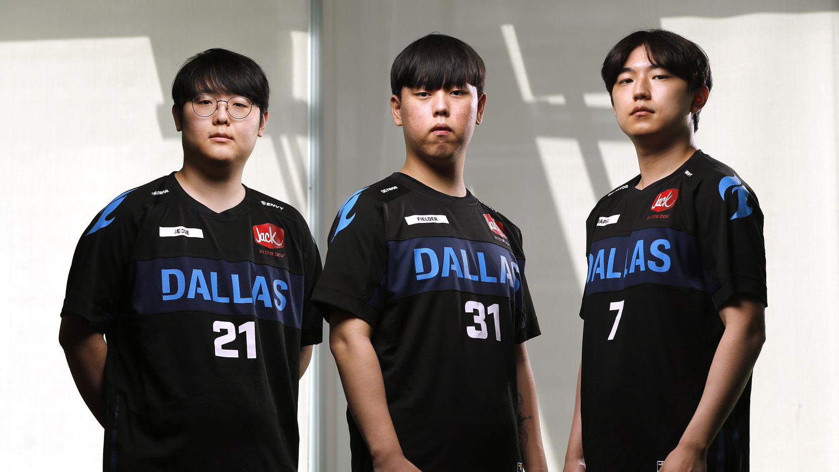 Dallas Fuel Overwatch League players Seung-soo 'Jecse' Lee, Kwon 'Fielder' Jun, and Jun Keun 'Rapel' Kim pose for a photo at Envy Gaming Headquarters in Dallas, Monday, March 29, 2021.
