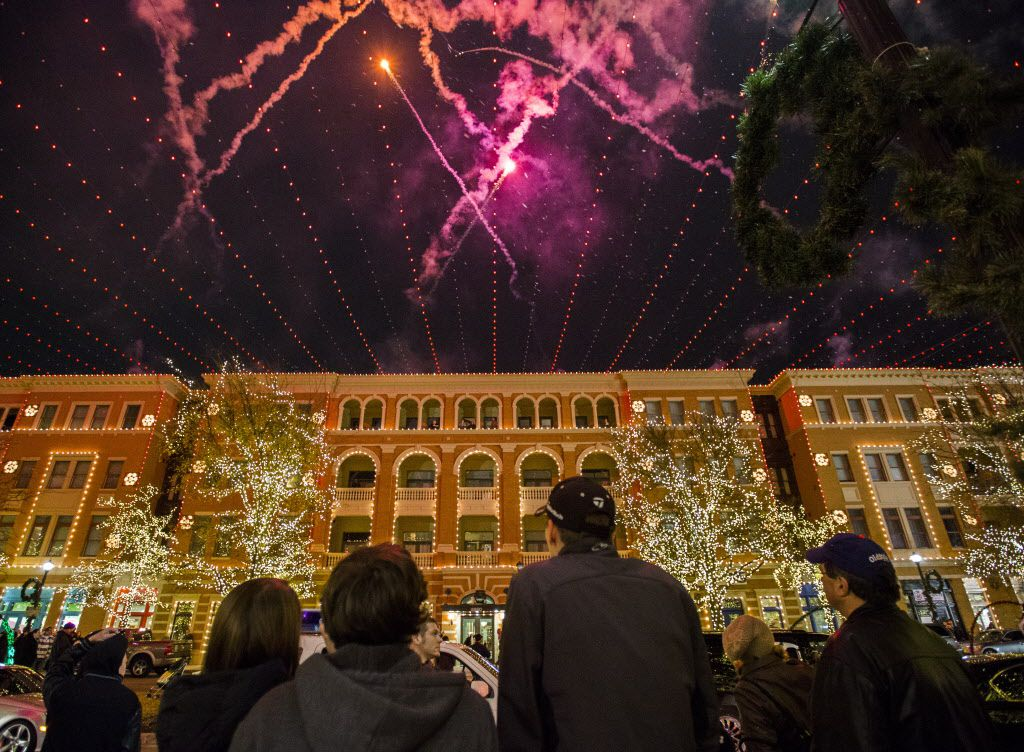 A firework a Christmas light show is displayed during the Christmas in the Square 10th Anniversary Celebration in Frisco, Texas on Saturday, December 20, 2014. (Ashley Landis/The Dallas Morning News)
