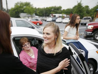Jennifer Wilson speaks to Bobbie Johnson (left) after receiving one of the vehicles Johnson donated to I Can Still Shine, a nonprofit that helps abused women and children. The nonprofit is among a number of local organizations that could use donations this holiday season.