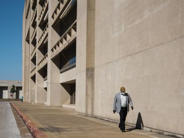A resident walks outside of Dallas City Hall on Wednesday, September 22, 2021 in Dallas, Texas. (Emil Lippe/Special Contributor)