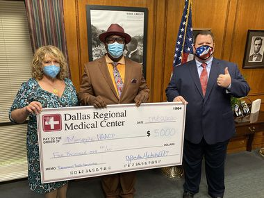 Dallas Regional Medical Center Chief Executive Officer Glenda Matchett, Mesquite NAACP President Henry Brown and Mesquite Mayor Bruce Archer pose with a check showing the DRMC's donation to the NAACP's upcoming scholarship program. The effort will support students looking to pursue careers in behavioral health.