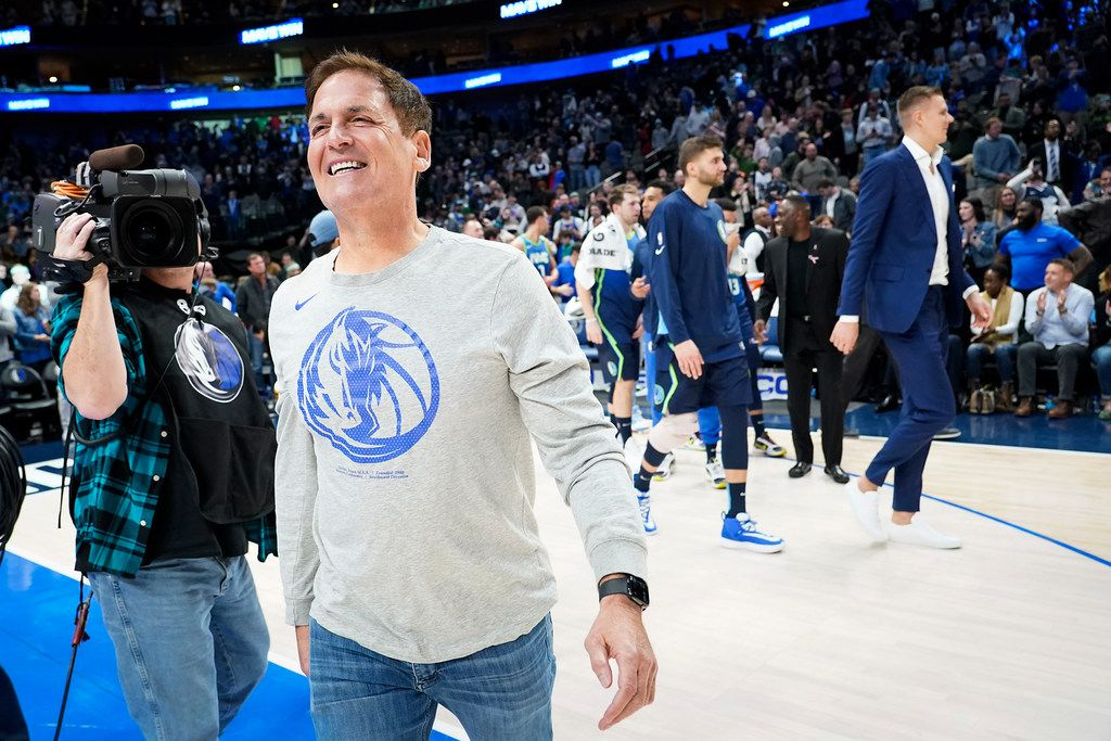 Dallas Mavericks owner Mark Cuban celebrates after the Mavericks 109-91 victory over the Philadelphia 76ers in an NBA basketball game at American Airlines Center on Saturday, Jan. 11, 2020, in Dallas.