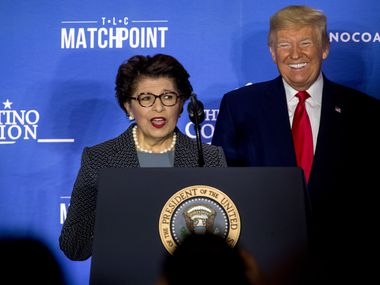 President Donald Trump listens as Small Business Administration Administrator Jovita Carranza speaks at the Latino Coalition Legislative Summit at the JW Marriott, Wednesday, March 4, 2020, in Washington.