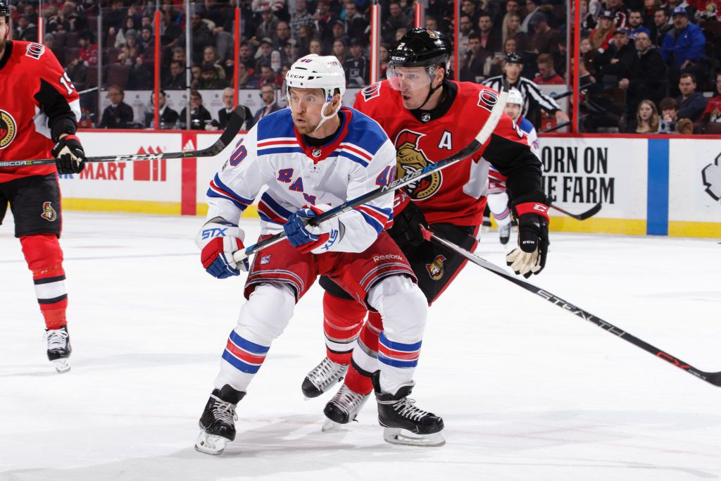 OTTAWA, ON - DECEMBER 13: Dion Phaneuf #2 of the Ottawa Senators skates against Michael Grabner #40 of the New York Rangers at Canadian Tire Centre on December 13, 2017 in Ottawa, Ontario, Canada.  (Photo by Jana Chytilova/Freestyle Photography/Getty Images