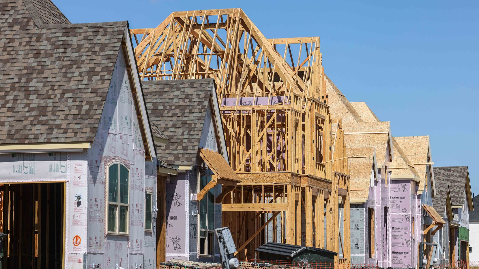 Construction material shortages and supply chain issues are adding months to home construction times.