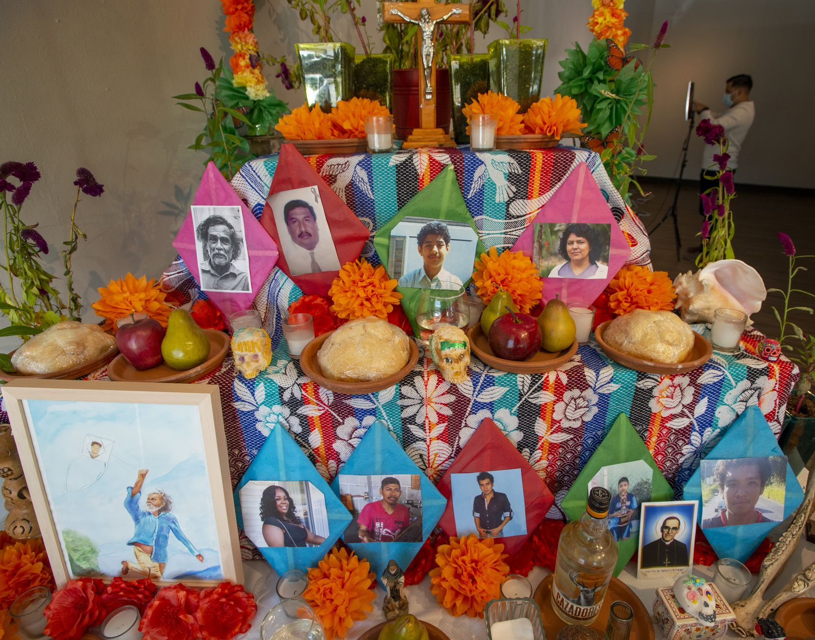 This Dia de Los Muertos altar by Pie de Lucha arts collective features a photo of the deceased 12-year-old Santos Rodriguez (below crucifix), at the Oak Cliff Cultural Center on October 30, 2020. Santos was murdered in 1973 in one of the nation's worst cases of police brutality.