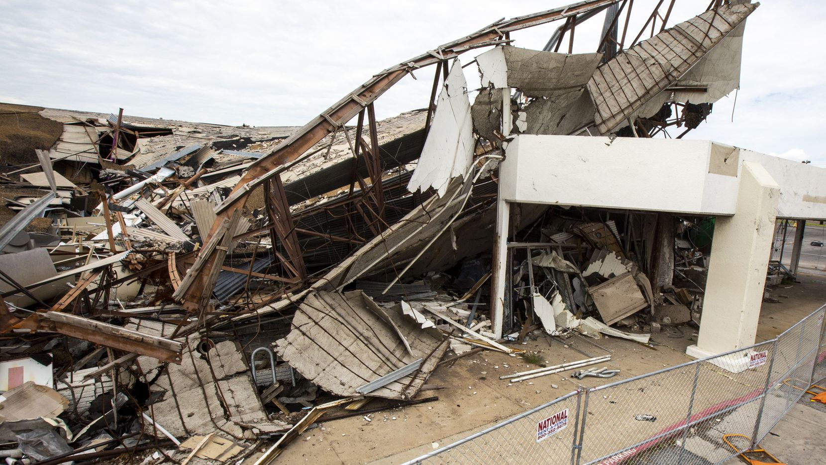 The Marsh Lane Plaza shopping center remains in complete disrepair from damage sustained during the October 2019 tornado in Dallas on Monday, April 7, 2020.