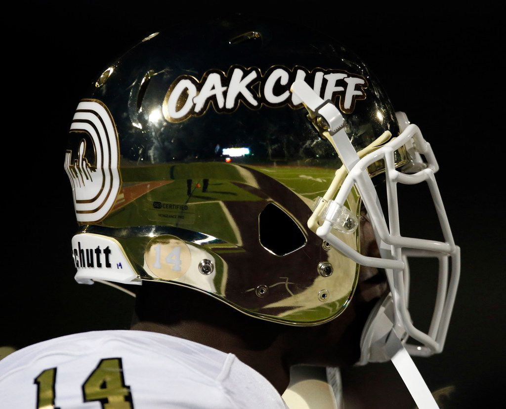 The South Oak Cliff players sport shinny gold helmets with the words Oak Cliiff of the side before the start of a high school football game against Kimball at Kincaide Stadium in Dallas on Saturday, November 2, 2018. (John F. Rhodes / Special Contributor)