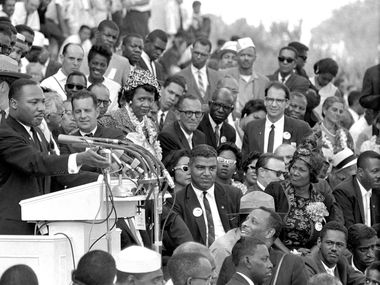 "The Rev. Dr. Martin Luther King Jr., head of the Southern Christian Leadership Conference, speaks to thousands during his ""I Have a Dream"" speech in front of the Lincoln Memorial for the March on Washington for Jobs and Freedom in Washington on Aug. 28, 1963. (AP Photo/File)"