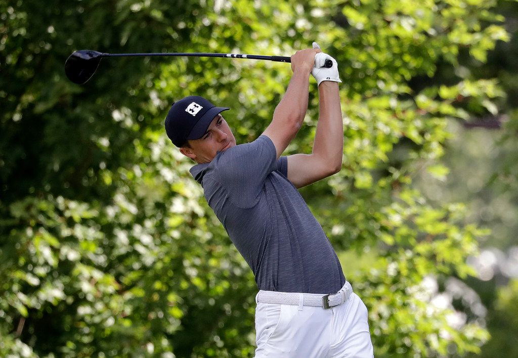 Jordan Spieth watches his tee shot on the fifth hole during the first round of the BMW Championship golf tournament at Medinah Country Club, Thursday, Aug. 15, 2019, in Medinah, Ill. (AP Photo/Nam Y. Huh)