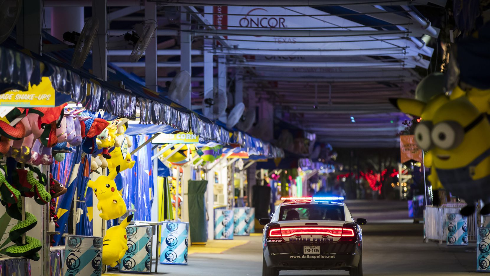 A Dallas police cruiser patrols the empty midway after closing at the State Fair of Texas.