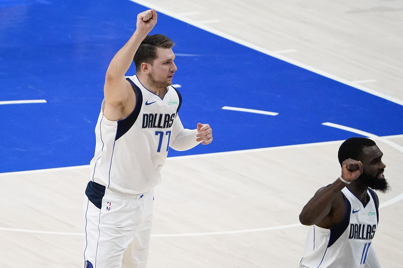 Dallas Mavericks guard Luka Doncic (77) celebrates a basket by forward Tim Hardaway Jr. (11) during the first quarter of an NBA playoff basketball game against the LA Clippers at American Airlines Center on Sunday, May 30, 2021, in Dallas.