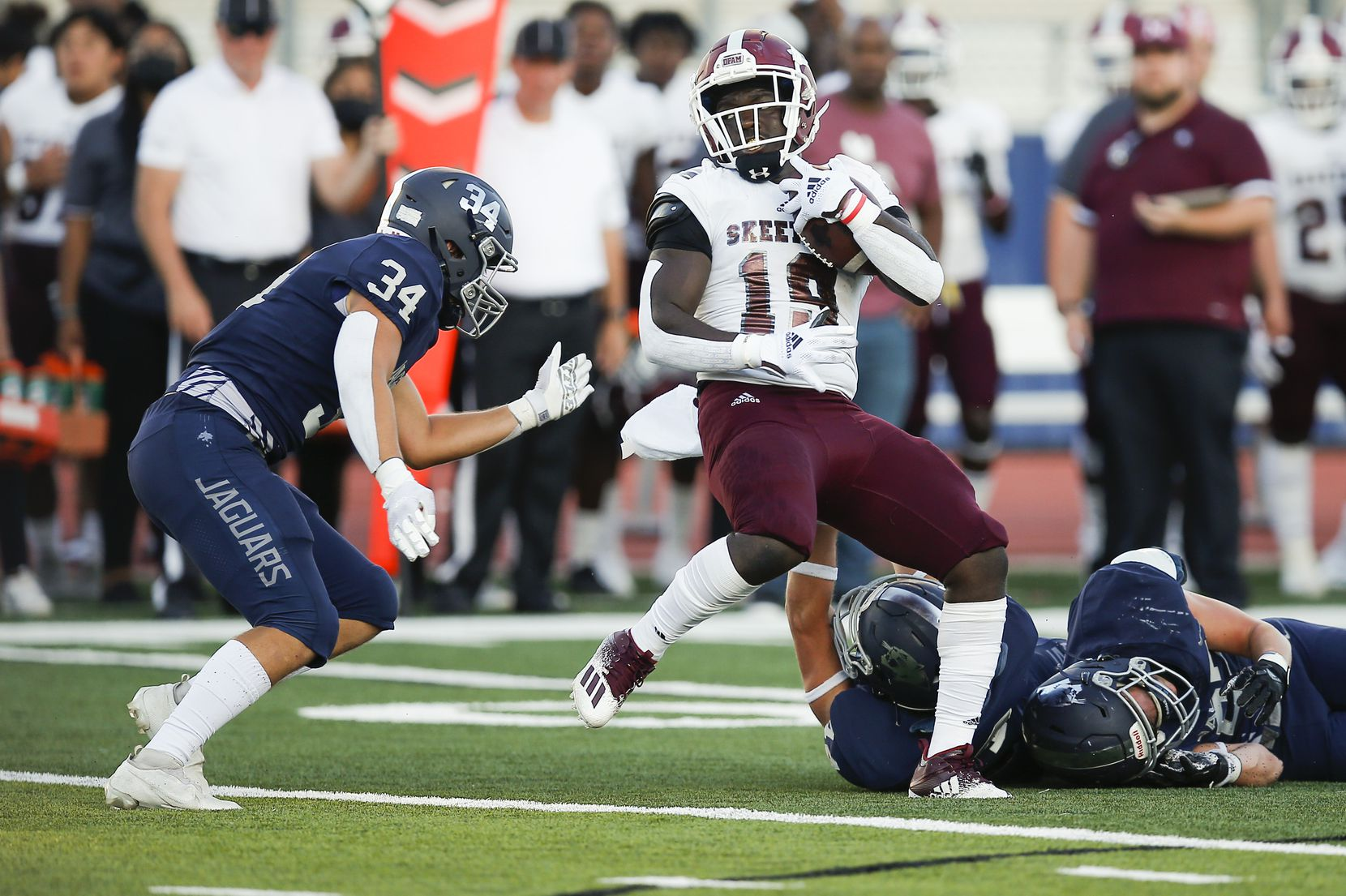 Mesquite senior running back Anthony Roberts (19) carries the ball as Flower Mound senior defensive end Luke Browning (34) defends during the first half of a high school football game at Flower Mound High School, Friday, August 27, 2021. (Brandon Wade/Special Contributor)