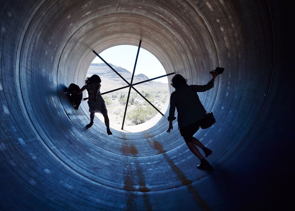 People walk through a hyperloop tube after the first test of a propulsion system at the Hyperloop One Test and Safety site on May 11, 2016, in North Las Vegas, Nev. The company plans to create a fully operational hyperloop system by 2021.