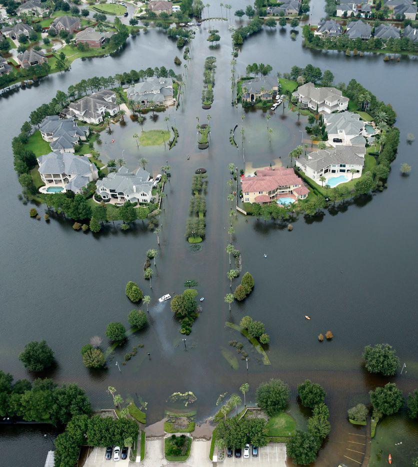 Flood waters have risen into the Lakes on Eldridge North neighborhood near the Addicks Reservoir  West Houston, Texas, Wednesday, August 30, 2017. Hurricane Harvey inundated the Houston area with several feet of rain. (Tom Fox/The Dallas Morning News)