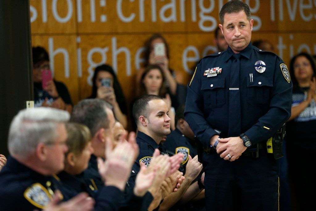 El Centro College police Officer John Abbott, who was injured during the ambush on July 7, 2016, stands to be recognized during the Renewal and Resilience Commemorative Ceremony to honor the fallen officers in the July 7, 2016 ambush at El Centro College in Dallas on Friday, July 7, 2017.