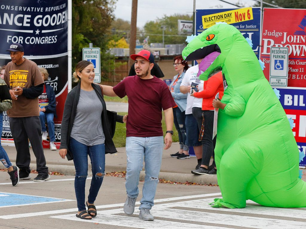 """First-time voters Rebecca Perez and Adrian Morales of Mesquite emerged from the early voting site at Lakeside Activity Center on Tuesday.  They said the crowd of people trying to influence their vote at the parking lot next to the polling place was """"kind of intimidating."""""""