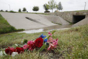 Flowers remain on the ground near the location where the body of 14-year-old Raymond Howell Jr, a McKinney Boyd High School freshman, was found last month. He died of a self-inflicted gunshot wound. (Andy Jacobsohn/The Dallas Morning News)