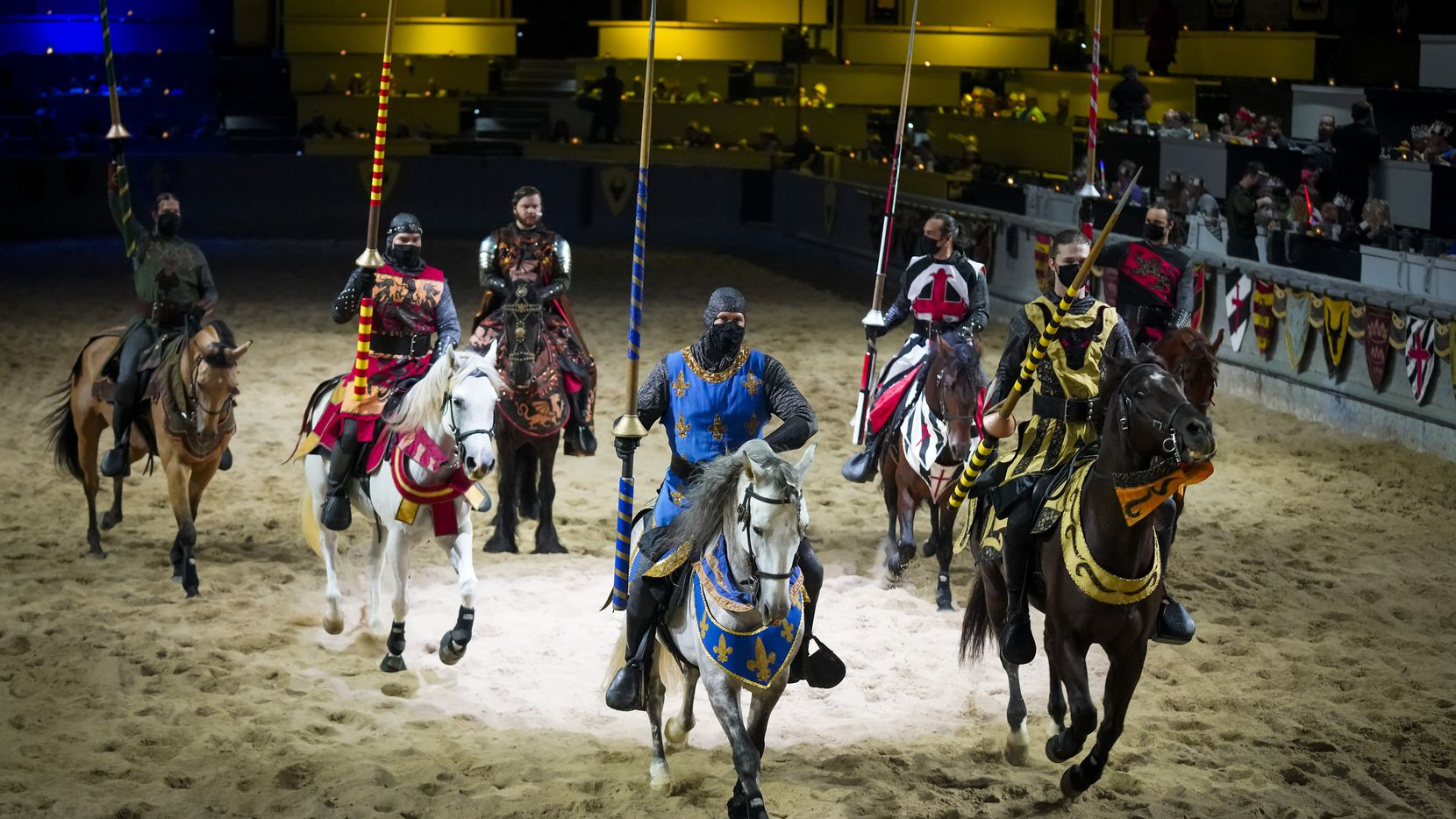 Knights wear face masks as they take part in a dinner show at Medieval Times on Thursday, Aug. 6, 2020, in Dallas.