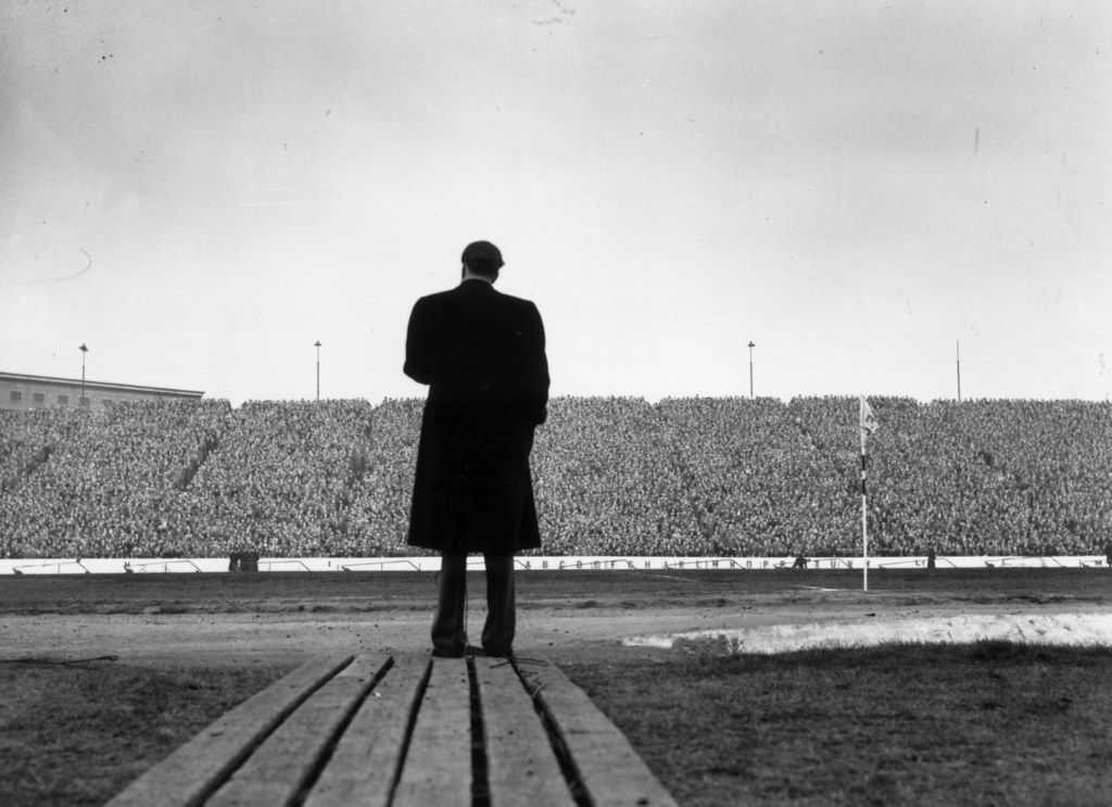 The Rev. Billy Graham addresses a crowd of football supporters at Stamford Bridge, London, during half-time at the match between Chelsea and Newcastle United.