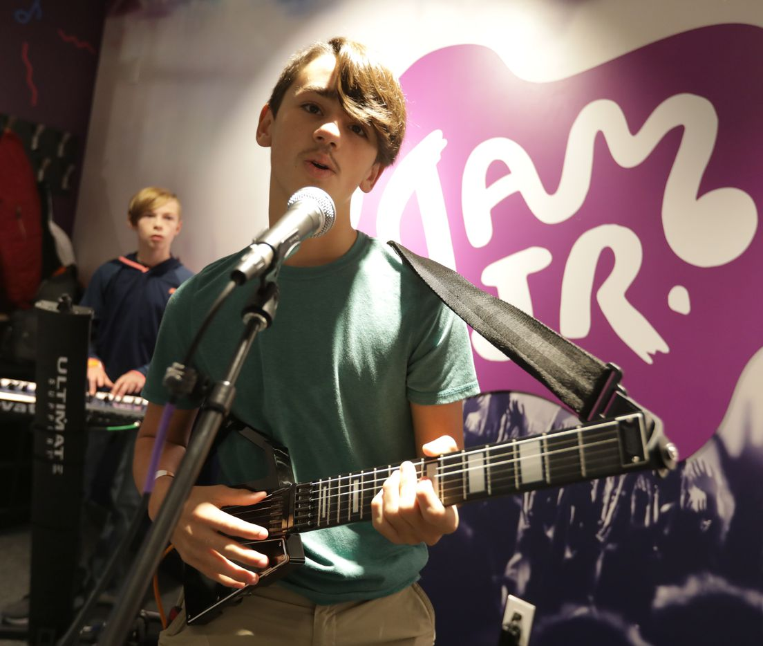 11-year-old Thatcher Dowdell, left, and 12-year-old Elliot Gearheart perform in a music studio at Stonebriar Centre's KidZania.