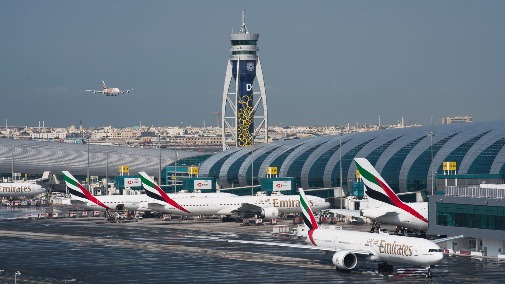 An Emirates jetliner comes in for landing at Dubai International Airport in Dubai, United Arab Emirates.