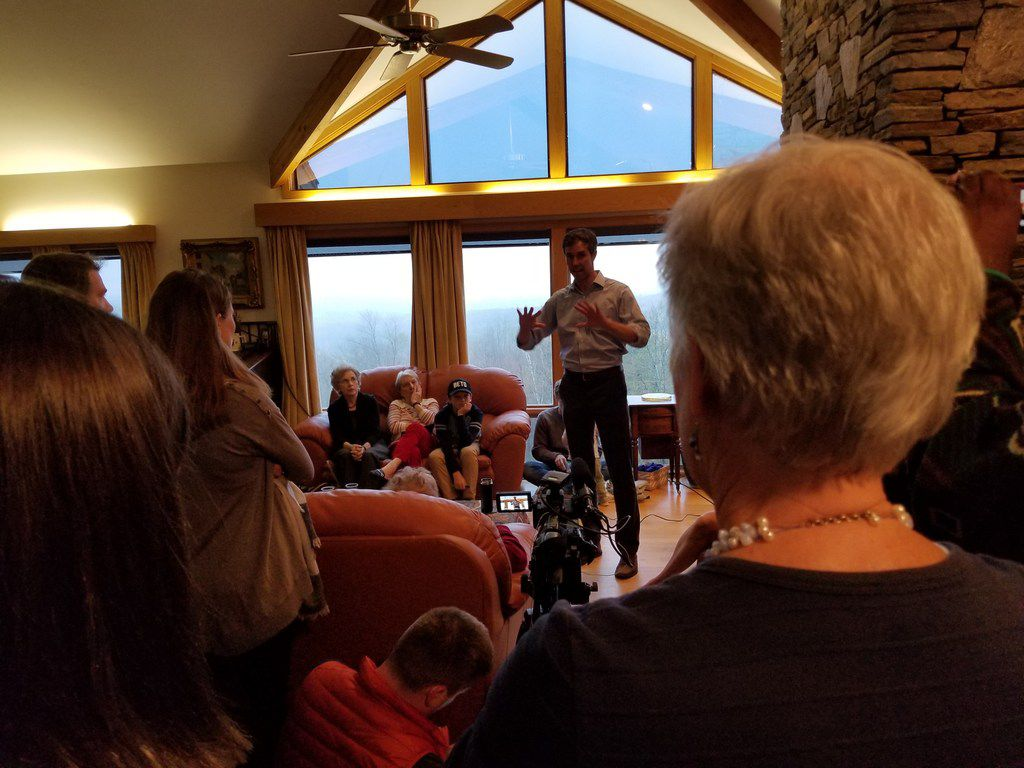 Deb Nelson (right), a history teacher who chairs the Hanover/Lyme Democratic Party, listens to presidential candidate Beto O'Rourke at a house party in Lebanon, N.H., on May 10, 2019. He was answering her questions about his refusal to endorse Gina Ortiz Jones over GOP Rep. Will Hurd in the 2018 elections.
