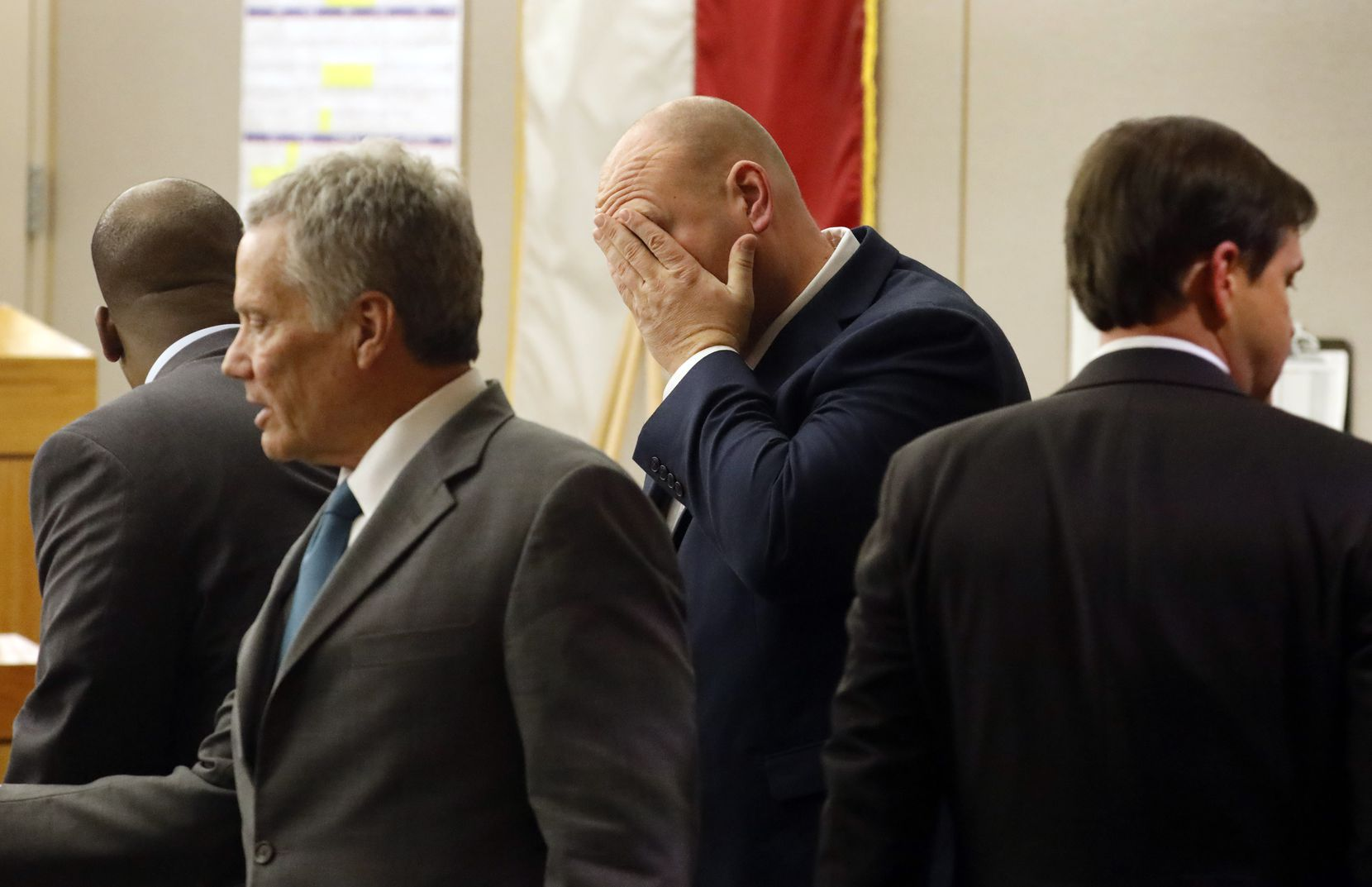 Former Dallas police officer Christopher Hess (middle) and his attorneys gathered at their desk before a lunch break in his aggravated assault trial in the 292nd District Court at the Frank Crowley Courts Building in Dallas Thursday, February 6, 2020. He's accused of the 2017 fatal shooting of 21-year-old Genevive Dawes. (Tom Fox/The Dallas Morning News)