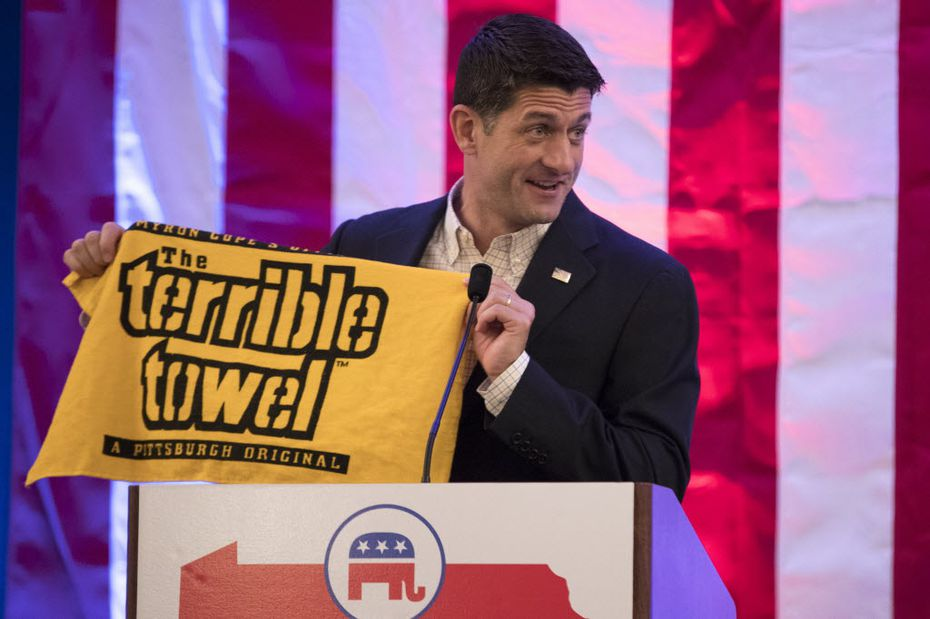 """Speaker of the House Rep. Paul Ryan, R-Wis., holds a """"Terrible Towel"""" during a breakfast Monday with Pennsylvania delegates during the Republican National Convention — a big step for a Packers fan."""