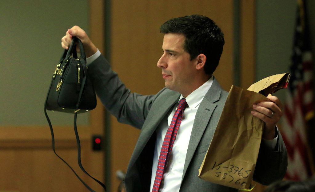 Defense attorney Cody Skipper holds up Anna Moses' purse that was found in the garage next to her body. It had $300 in cash. But police did not find the credit card she used to purchase a quesadilla.