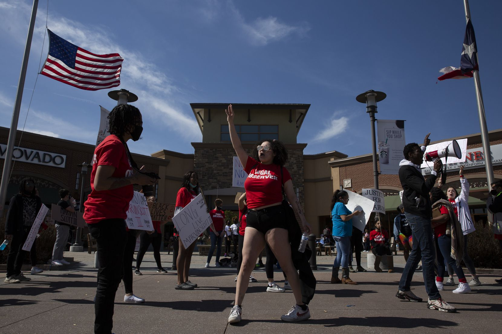 """People march to the Allen Outlets on Sunday, March 21, 2021 demanding justice for Marvin Scott III, who died a week prior while in custody at the Collin County Jail on March 14, 2021. Marvin Scott III was arrested at the Allen Outlets for possession of less than two ounces of marijuana. Demonstrators called for the arrest of the """"Collin County Seven"""", the seven Collin County Jail employees who were placed on leave after Marvin's death. (Shelby Tauber/Special Contributor)"""