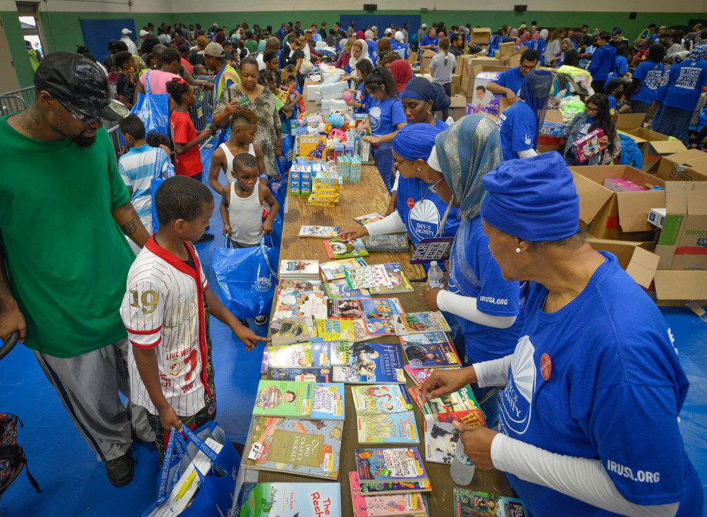 Volunteers from Dallas-area mosques handed out books, clothing, coats, meals and hygiene kits during the Islamic Relief USA's Day of Dignity at the MLK Center in Dallas on Sept. 22, 2018.