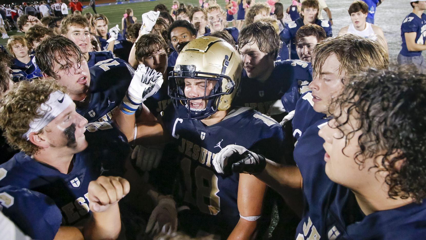Jesuit senior running back Robert Fitzgerald, center, and his teammates celebrate a 48-45 win over Lake Highlands after a high school football game at Jesuit College Preparatory School of Dallas, Friday, October 1, 2021. (Brandon Wade/Special Contributor)