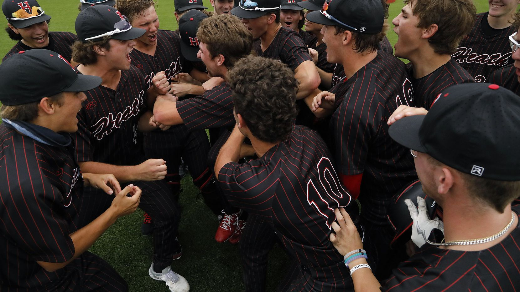 Rockwall-Heath celebrates their run rule victory, 10-0, in the sixth inning as Rockwall Heath High School hosted Sachse High School in a game three of a three game series to determine the 6A Region II quarterfinals at Wylie East High School on Saturday, May 22, 2021.