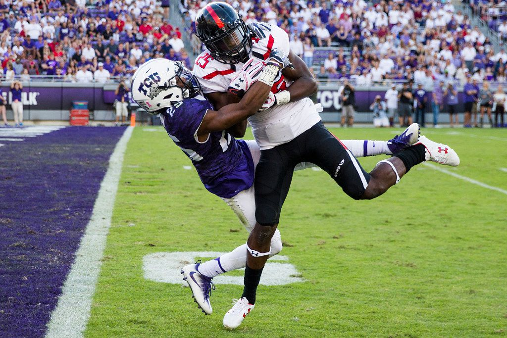 Texas Tech defensive back Douglas Coleman (25) intercepts a pass intended for TCU wide receiver KaVontae Turpin (25) during the second half of an NCAA football game at Amon G. Carter Stadium on Saturday, Oct. 29, 2016, in Fort Worth. (Smiley N. Pool/The Dallas Morning News)