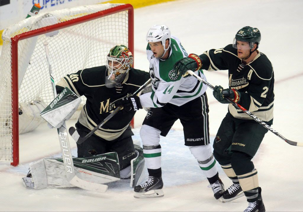 Apr 24, 2016; Saint Paul, MN, USA; Minnesota Wild defenseman Ryan Suter (20) defends against Dallas Stars forward Jamie Benn (14) in front of goalie Devan Dubnyk (40) during the third period in game six of the first round of the 2016 Stanley Cup Playoffs at Xcel Energy Center.  The Stars win 5-4 over the Wild.  Mandatory Credit: Marilyn Indahl-USA TODAY Sports ORG XMIT: USATSI-268018