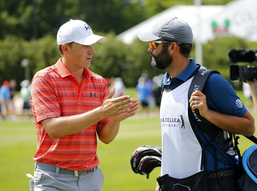 Golfer Jordan Spieth (left) converses with his caddie Michael Greller following his first nine during the second round of the Dean and Deluca Invitational at the Colonial Country Club in Fort Worth, Friday, May 27, 2016. (Tom Fox/The Dallas Morning News)
