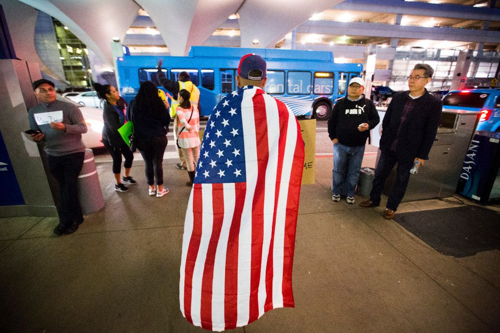 Absaar Ateeq, a UTD student from Plano, heads to the parking lot as a protest in opposition to President Donald Trump's executive order barring certain travelers at DFW International Airport  breaks up on Sunday, Jan. 29, 2017. Multiple travelers were detained at DFW after Trump shut borders. (Smiley N. Pool/The Dallas Morning News)