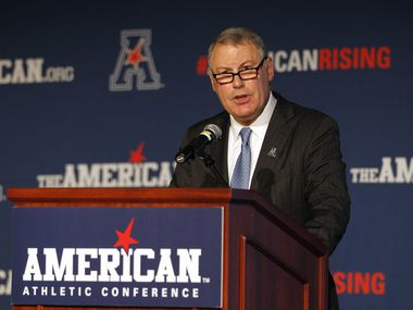 In this Aug. 4, 2015 file photo, American Athletic Conference Commissioner Mike Aresco addresses the media during an NCAA football media day in Newport, R.I. with Big 12 expansion talks looming. (AP Photo/Stew Milne)