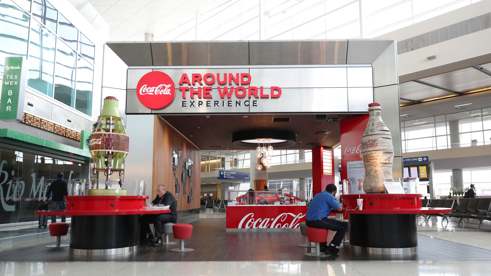 The new Coca-Cola Around the World Experiences space at DFW International Airport in Terminal D features a small Coke museum, an interactive photo booth and a place to plug in devices between flights.