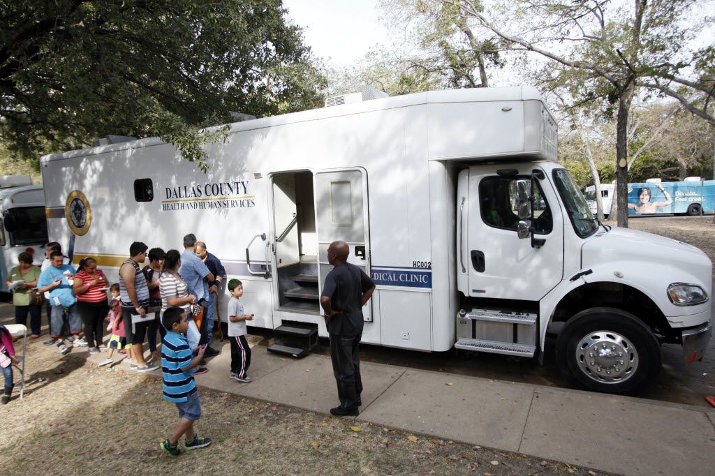 Men and women waited outside the Dallas County Health and Human Services bus to receive STD tests during a health fair  hosted in Dallas with the Mexican Consulate in 2015.